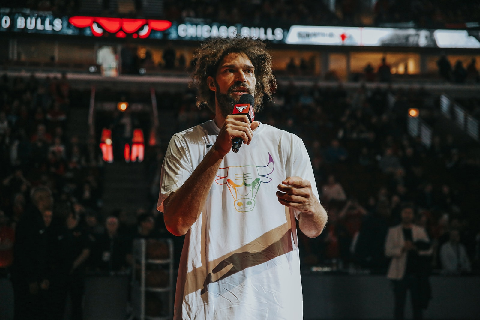 Robin Lopez speaks to the crowd before the start of a Bulls game.