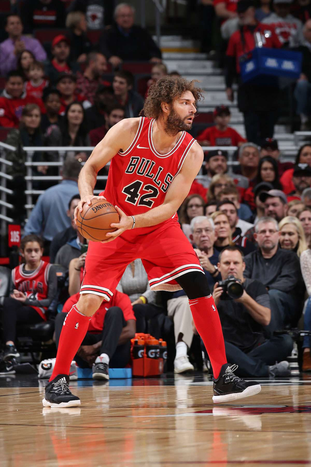 Robin Lopez #42 of the Chicago Bulls handles the ball against the Miami Heat on November 26, 2017 at the United Center in Chicago, Illinois.