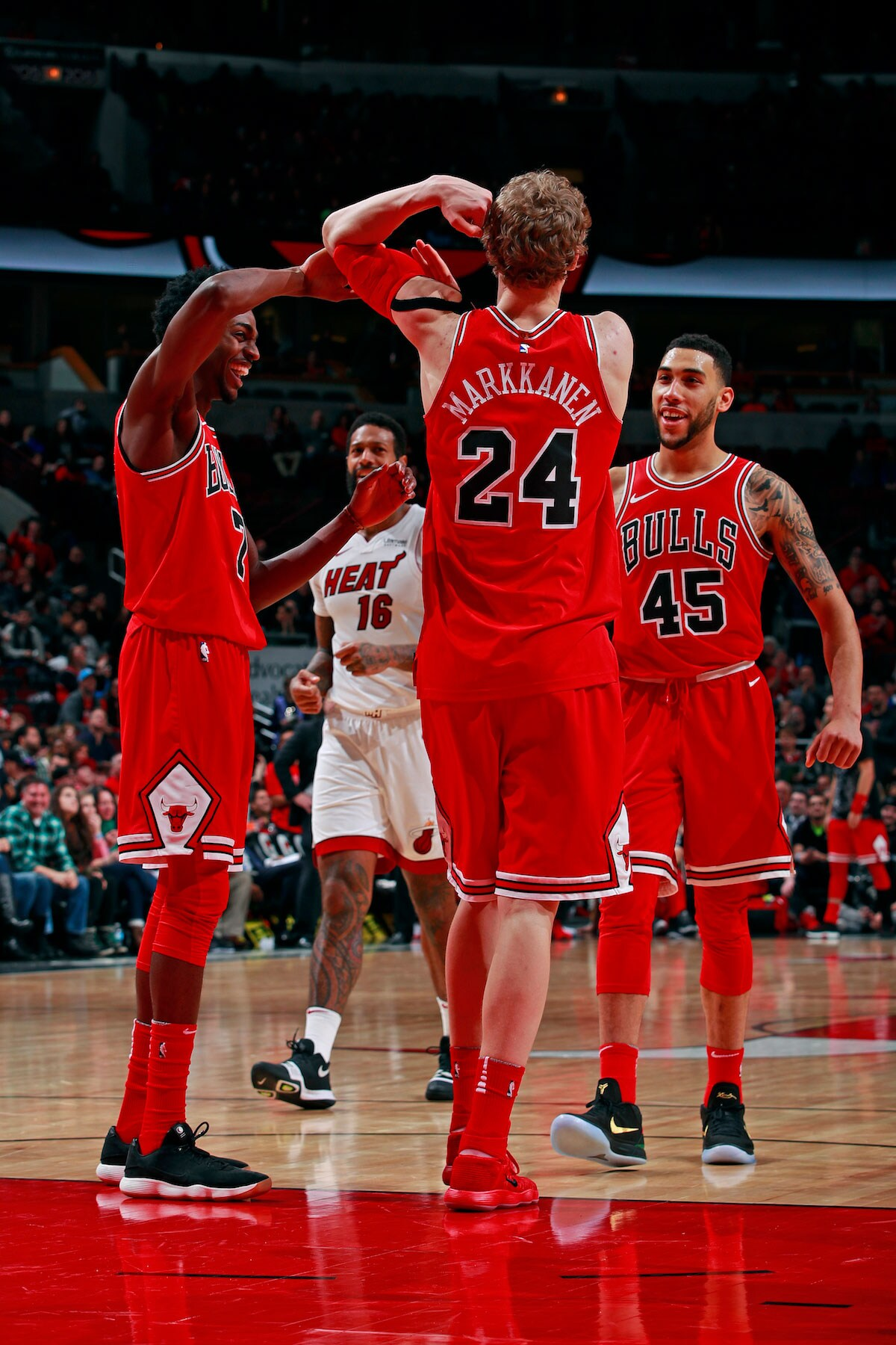 Lauri Markkanen #24 of the Chicago Bulls celebrates while flexing during the game against the Miami Heat on January 15, 2018 at the United Center in Chicago, Illinois