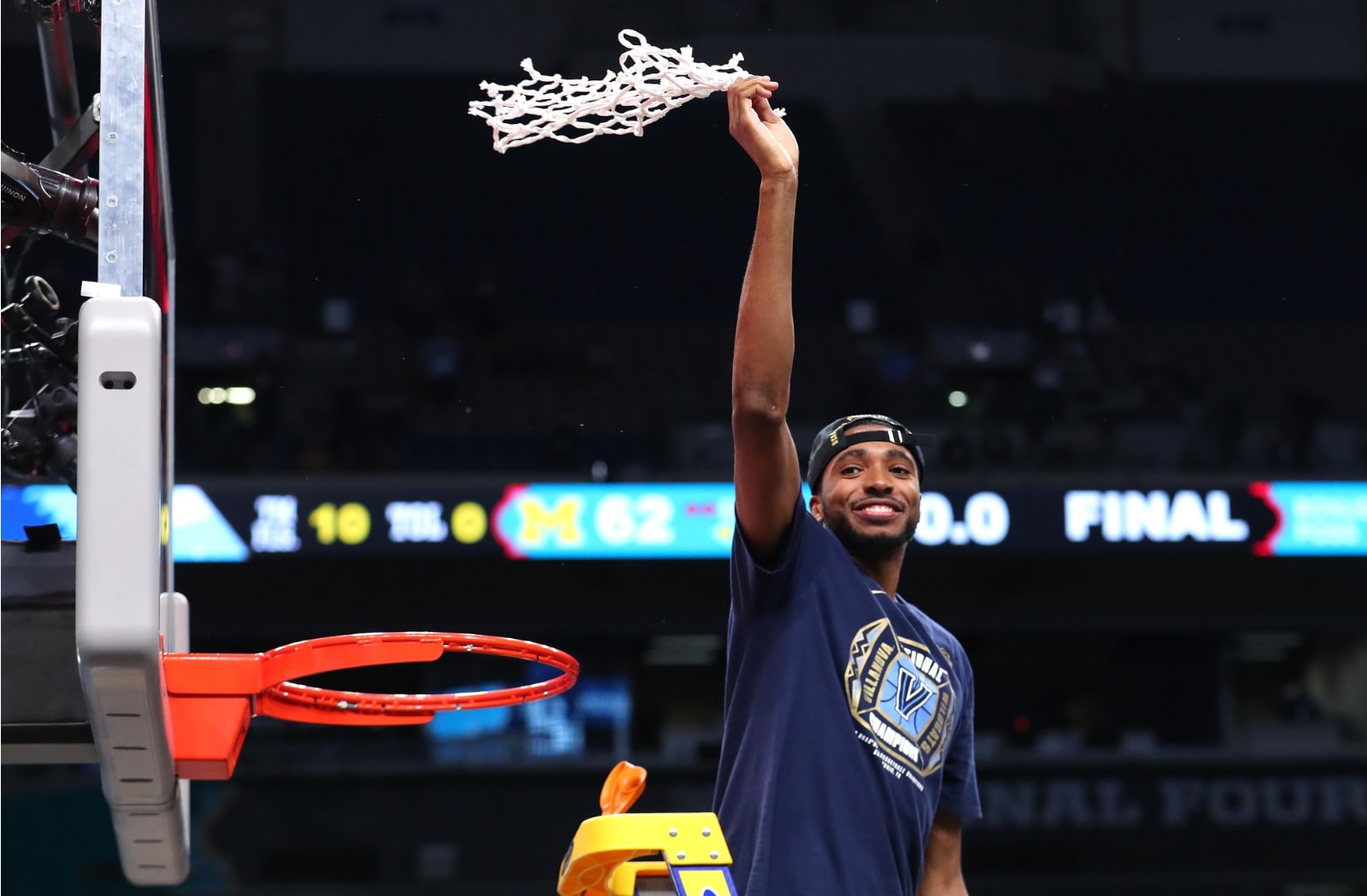 Mikal Bridges cuts down the net after winning the National Championship