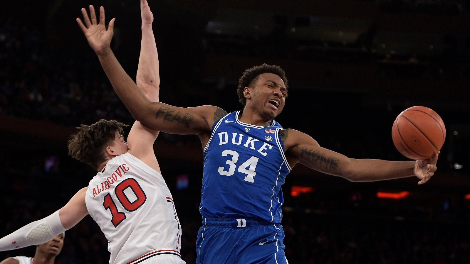 Wendell Carter grabs a rebound for Duke