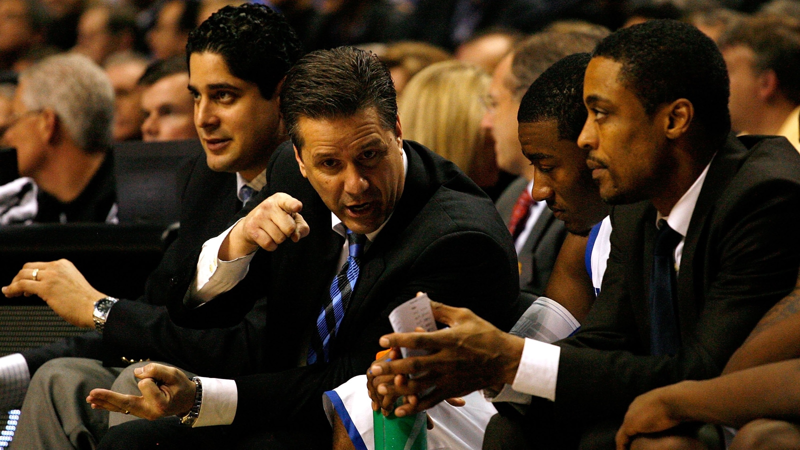 Rod Strickland sits on the bench as assistant coach for Kentucky men's basketball