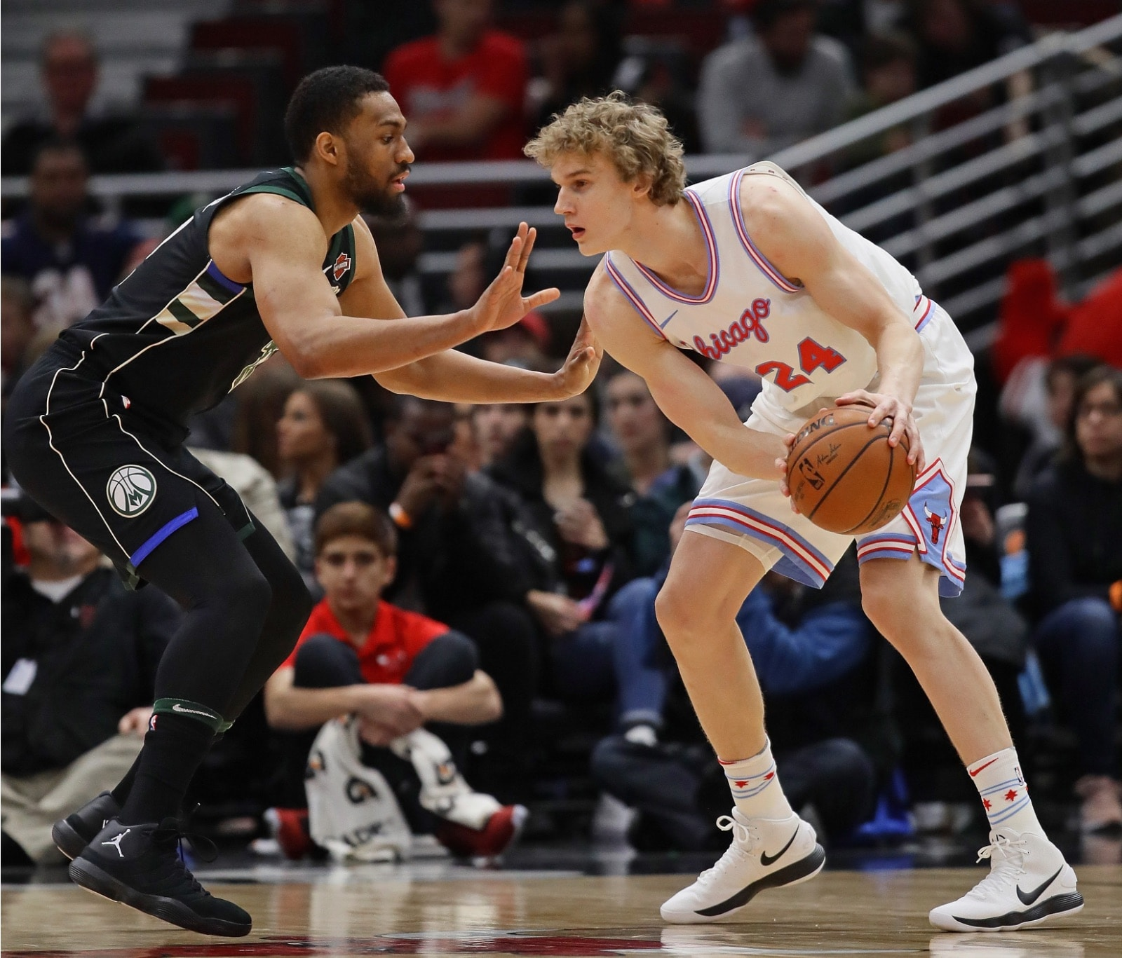 Jabari Parker squares up against Lauri Markkanen