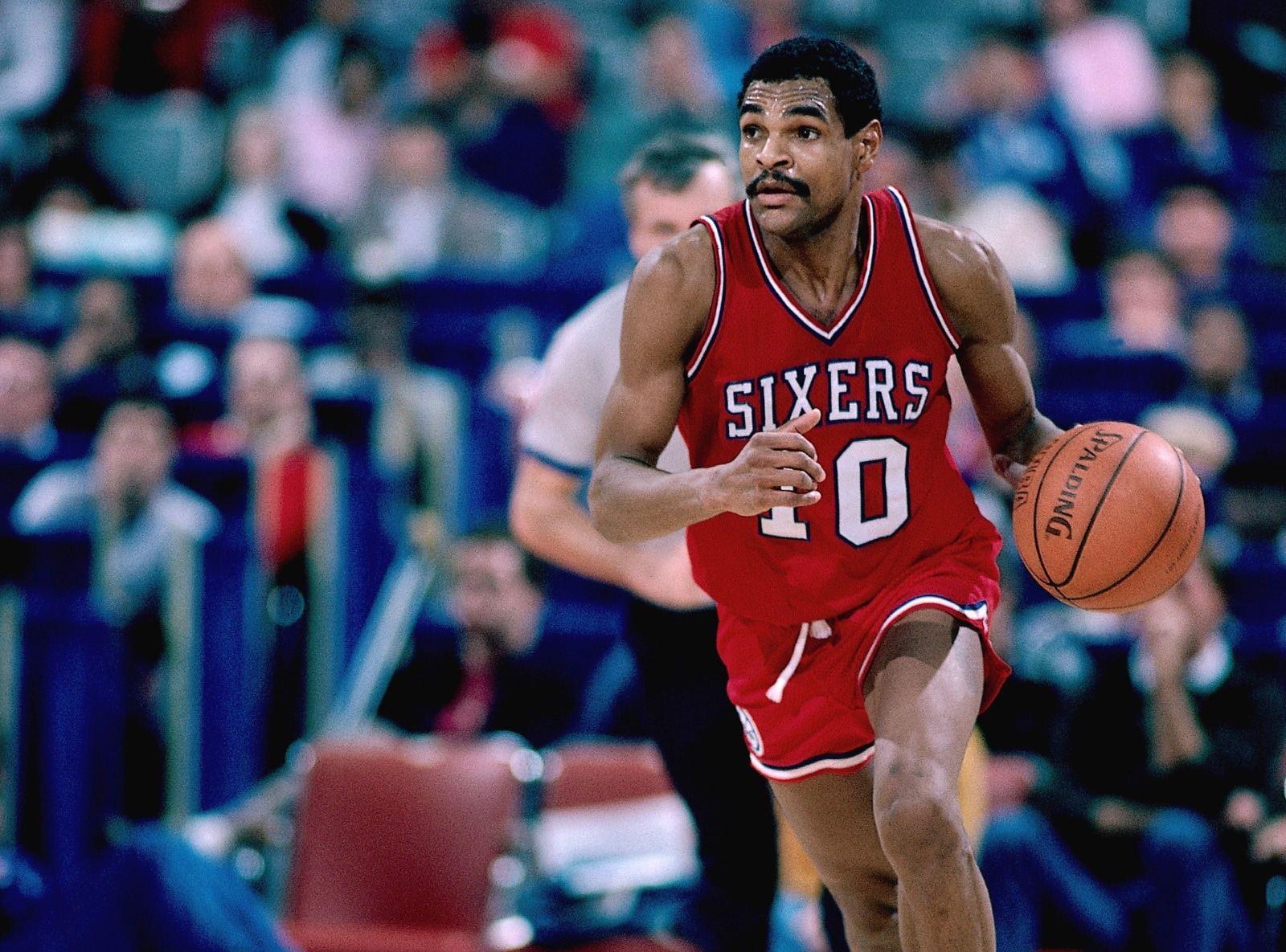 Mo Cheeks dribbles down the court for the Philadelphia 76ers