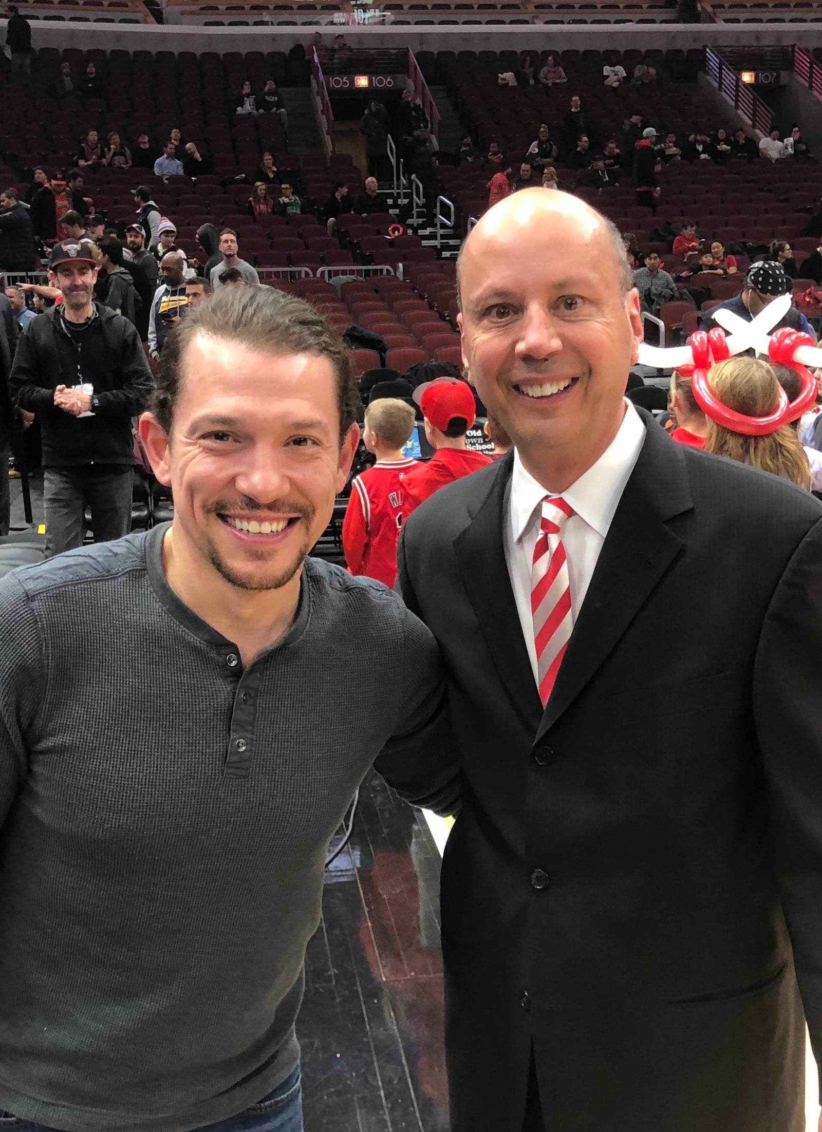 Miguel Cervantes from Hamilton poses with Chuck Swirsky
