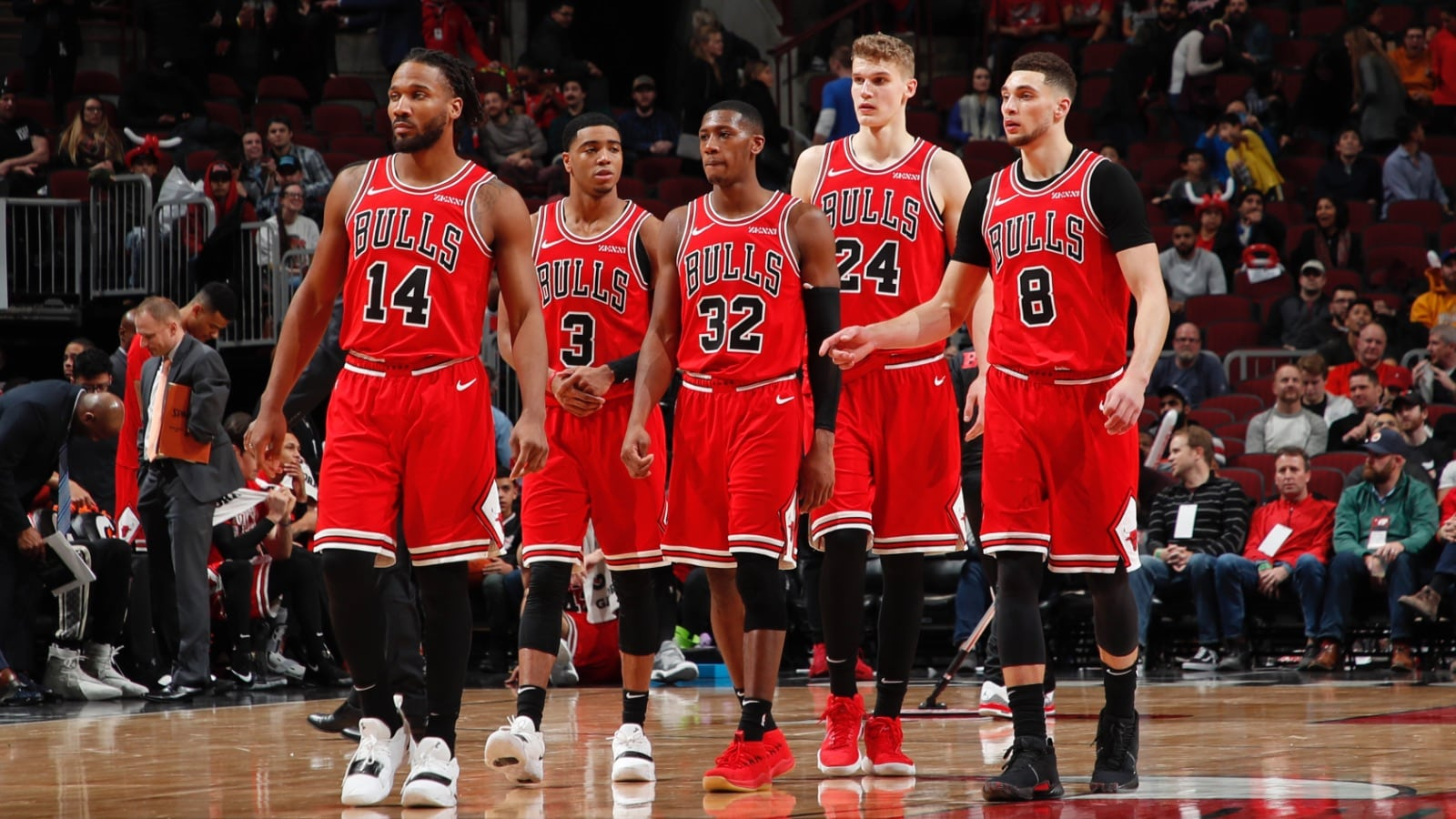 Bulls team walks on the court