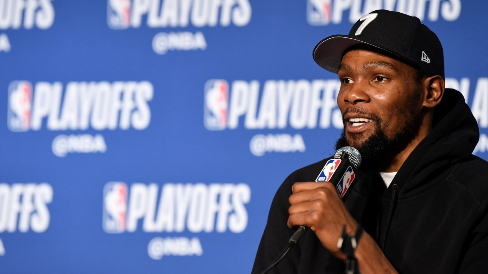 Kevin Durant speaks to the media following a playoff game