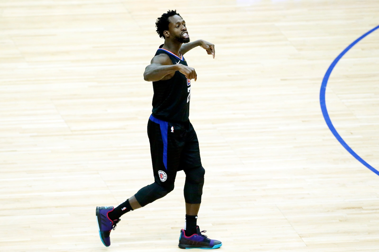 Patrick Beverley #21 of the LA Clippers gets hyped during the game against the Golden State Warriors during Game Five of Round One of the 2019 NBA Playoffs