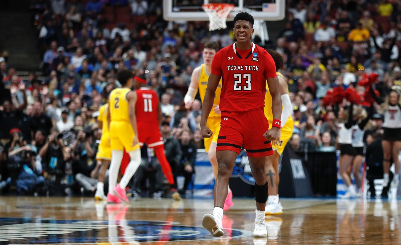 Jarrett Culver #23 of the Texas Tech Red Raiders celebrates after a play against the Michigan Wolverines during the 2019 NCAA Men's Basketball Tournament West Regional at Honda Center on March 28, 2019 in Anaheim, California.