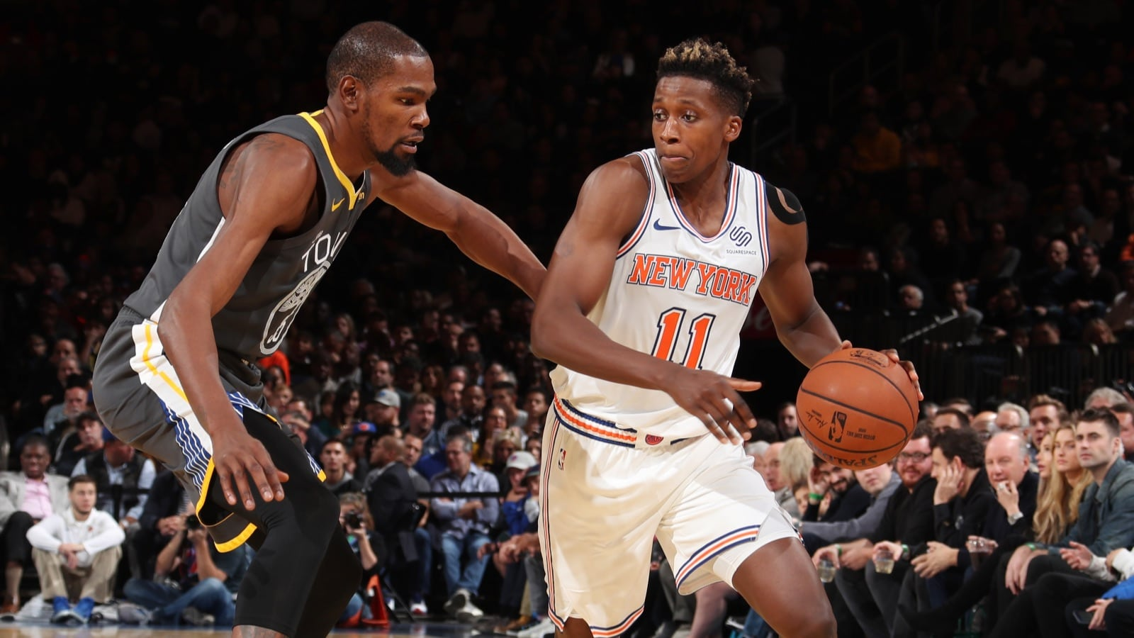 Kevin Durant #35 of the Golden State Warriors defends against Frank Ntilikina #11 of the New York Knicks during the game on October 26, 2018 at Madison Square Garden in New York City, New York.