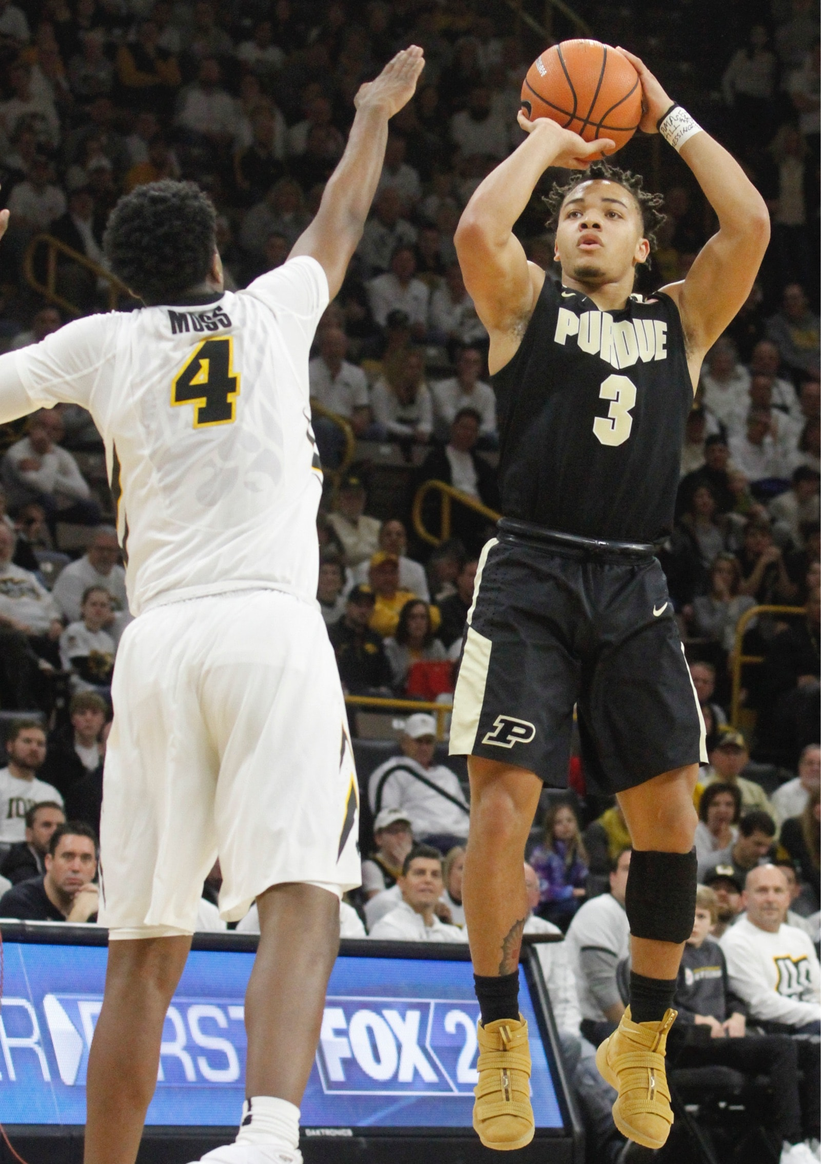 Guard Carson Edwards #3 of the Purdue Boilermakers takes a shot during the first half in front of guard Isaiah Moss #4 of the Iowa Hawkeyes on January 20, 2018 at Carver-Hawkeye Arena, in Iowa City, Iowa.