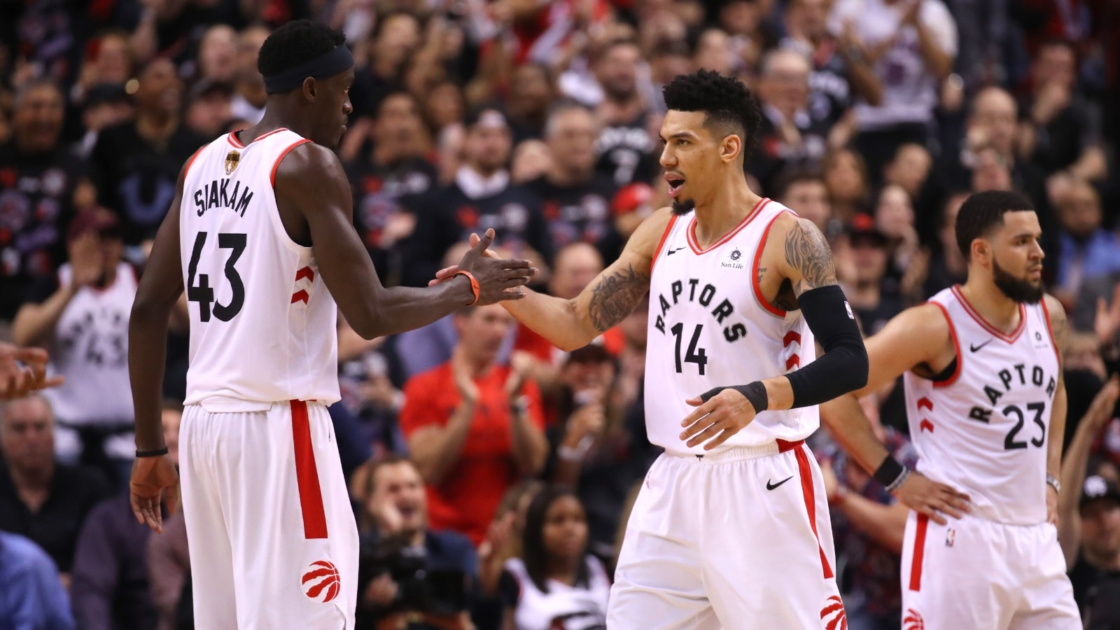 Pascal Siakam #43 and Danny Green #14 of the Toronto Raptors celebrate the play against the Golden State Warriors in the second half during Game One of the 2019 NBA Finals at Scotiabank Arena on May 30, 2019 in Toronto, Canada.