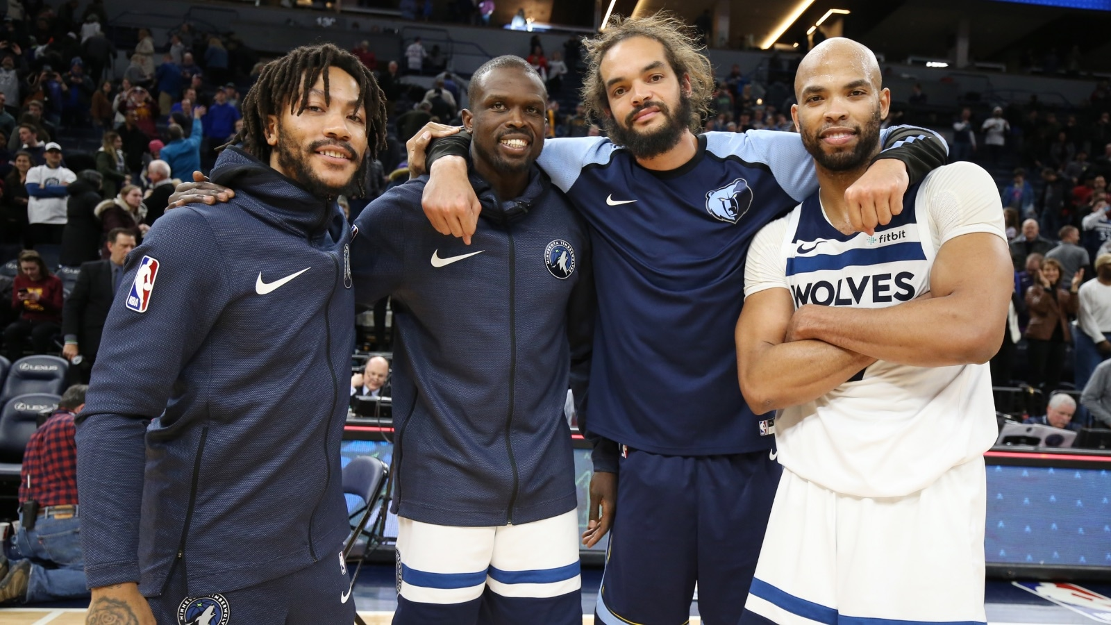 Derrick Rose #25 of the Minnesota Timberwolves, Luol Deng #9 of the Minnesota Timberwolves, Joakim Noah #55 of the Memphis Grizzlies, and Taj Gibson #67 of the Minnesota Timberwolves pose for a photo following the game on January 30, 2019 at Target Center in Minneapolis, Minnesota.