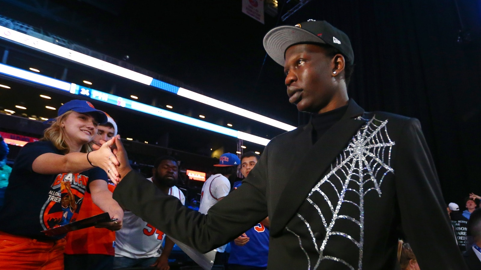 Bol Bol high fives fans after being selected forty-fourth overall by the Miami Heat during the 2019 NBA Draft on June 20, 2019 at the Barclays Center in Brooklyn, New York.