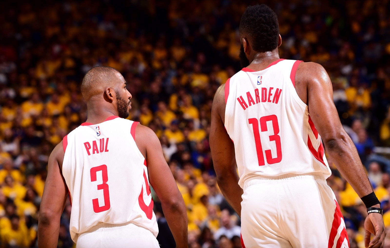 Chris Paul #3 and James Harden #13 of the Houston Rockets look on during Game Two of the Western Conference Semifinals of the 2019 NBA Playoffs against the Golden State Warriors on April 30, 2019 at ORACLE Arena in Oakland, California.