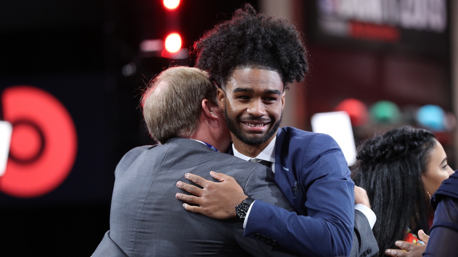 Coby White hugs and celebrates after hearing his name called in the 2019 NBA Draft