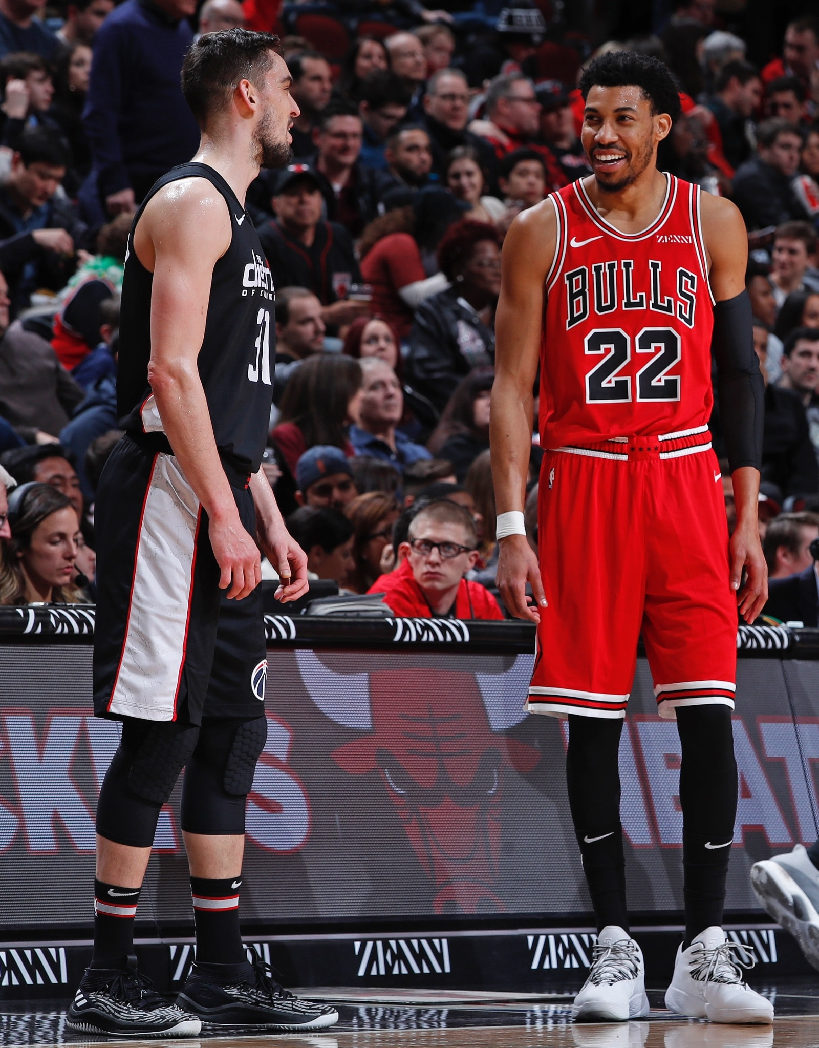 Tomas Satoransky #31 of the Washington Wizards and Otto Porter Jr. #22 of the Chicago Bulls speak during the game on February 9, 2019 at United Center in Chicago, Illinois.
