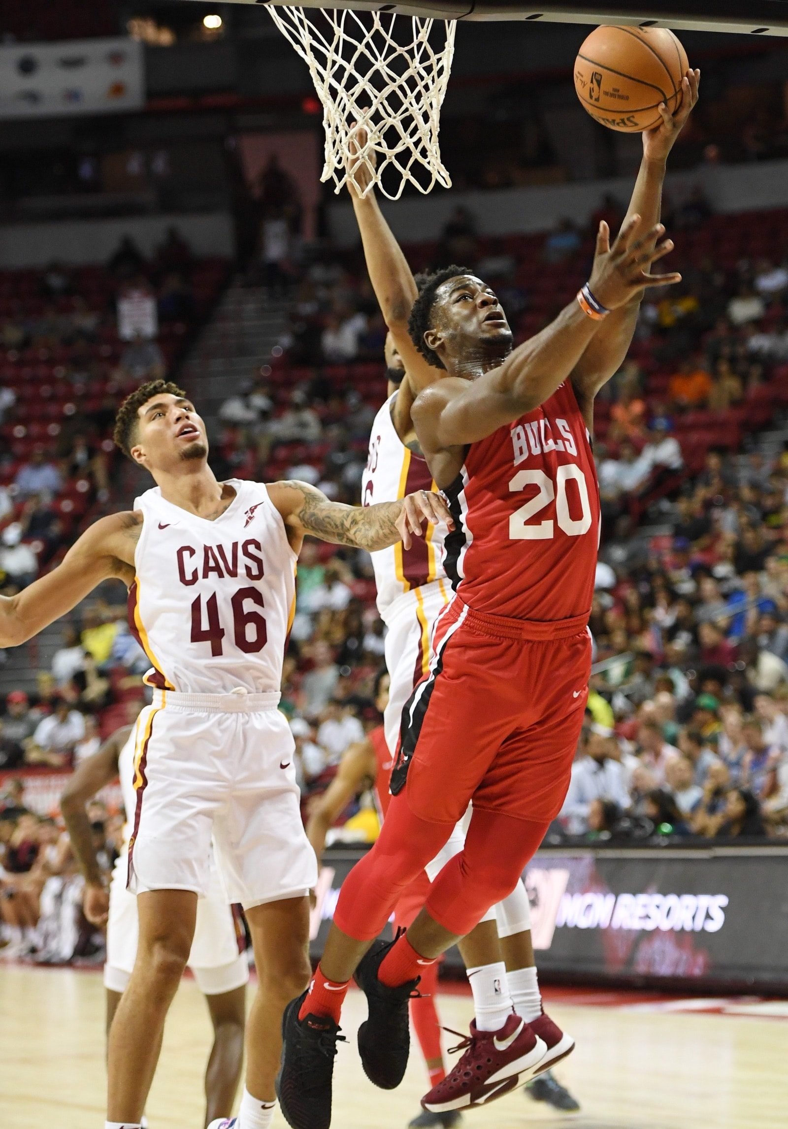 Adam Mokoka #20 of the Chicago Bulls shoots a layup ahead of Sandy Cohen III #46 of the Cleveland Cavaliers during the 2019 NBA Summer League at the Thomas & Mack Center on July 7, 2019 in Las Vegas, Nevada.