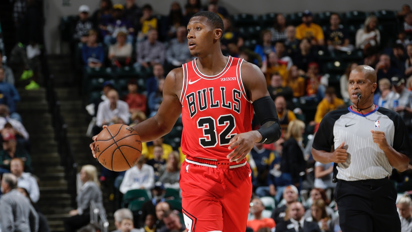 Kris Dunn dribbles the ball up the court