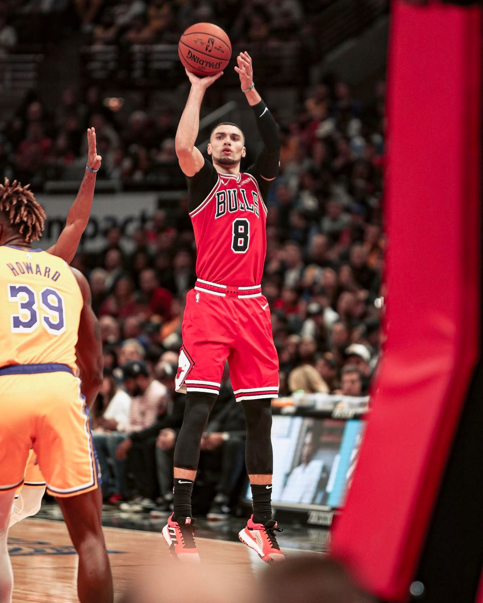 Zach LaVine shoots a three against the Los Angeles Lakers.