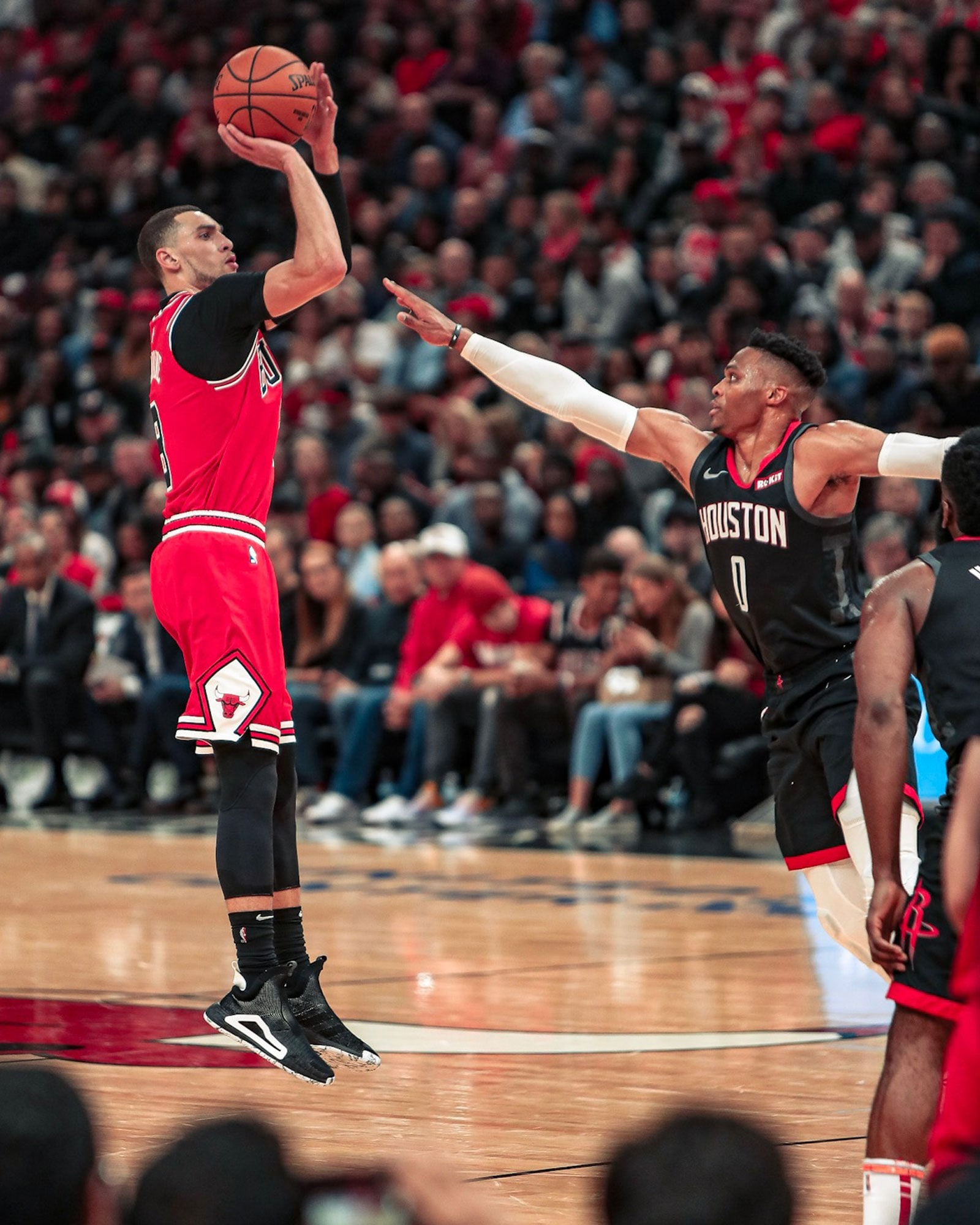 Zach LaVine shoots a three against Houston's Russell Westbrook.