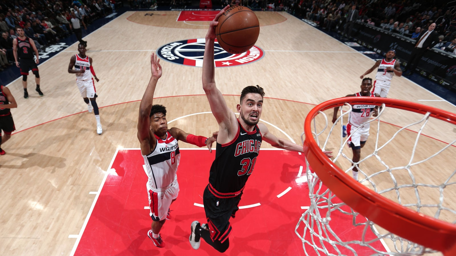 Tomas Satoransky flies in for a dunk against his former team.