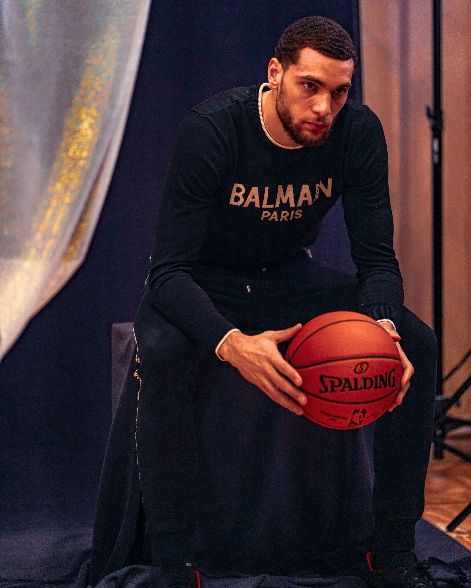 Zach LaVine sits at a photo shoot on the first day of All-Star weekend.