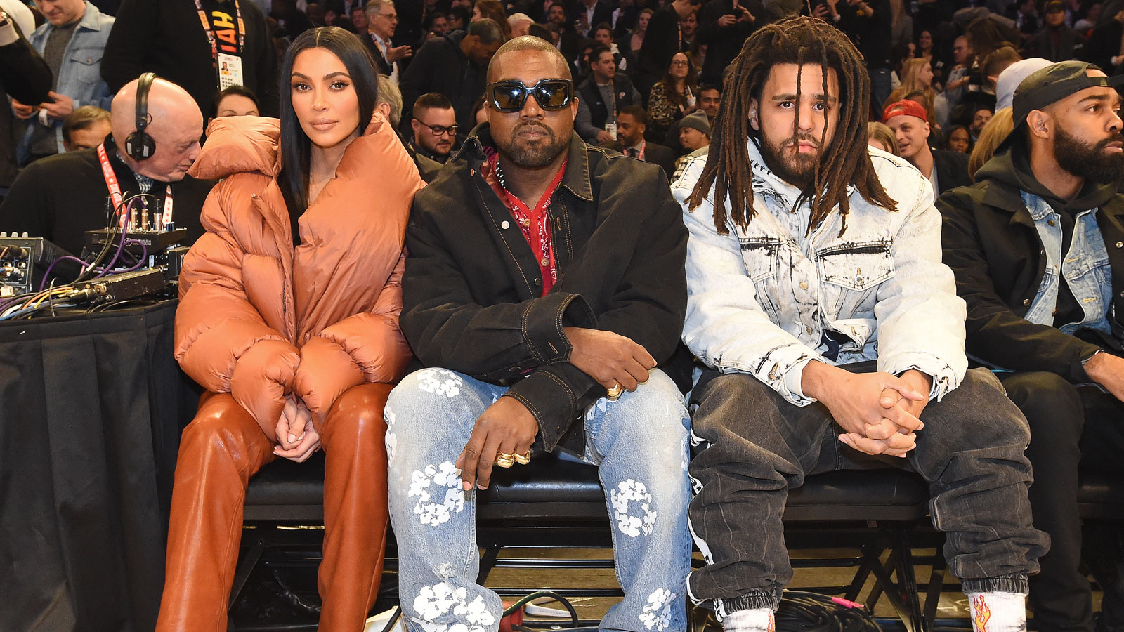 Chicago native Kanye West sat courtside of the All-Star game next to his wife Kim Kardashian and rapper J. Cole.