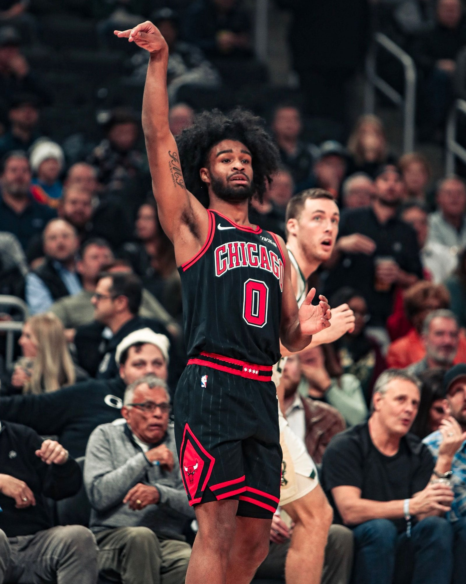 Coby White shoots a three against Milwaukee.
