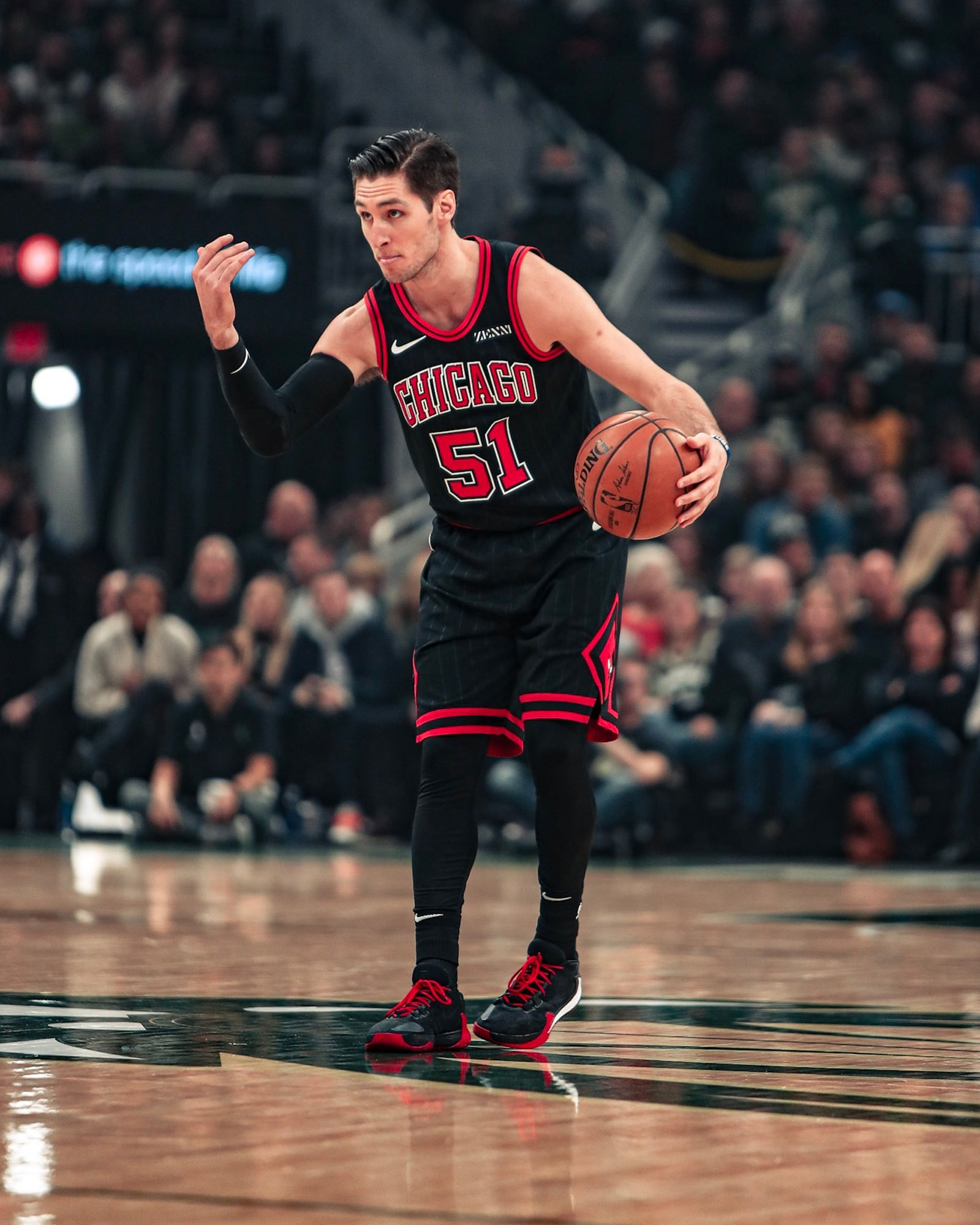 Ryan Arcidiacono signals for a play.