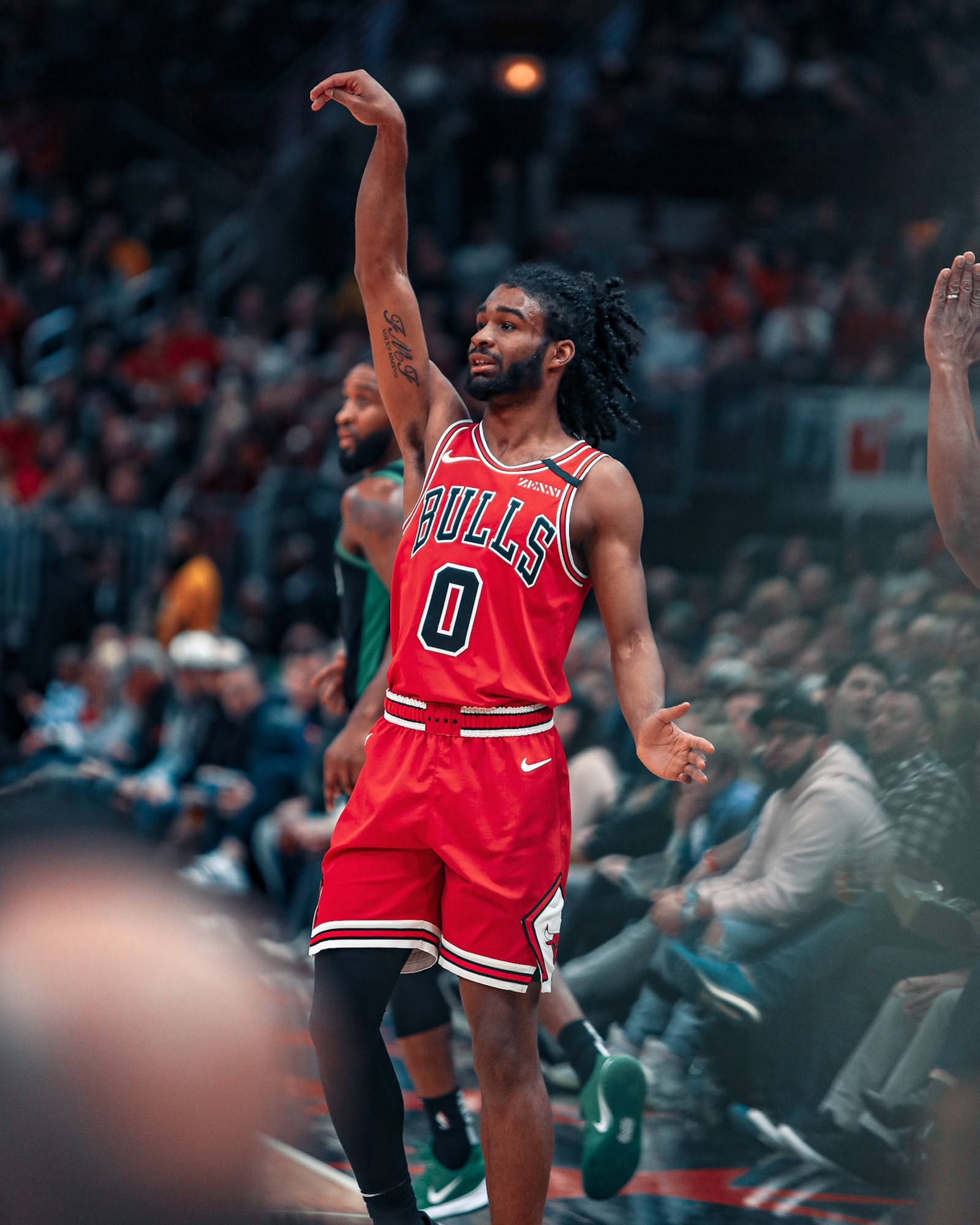 Coby White shoots a three against Boston.