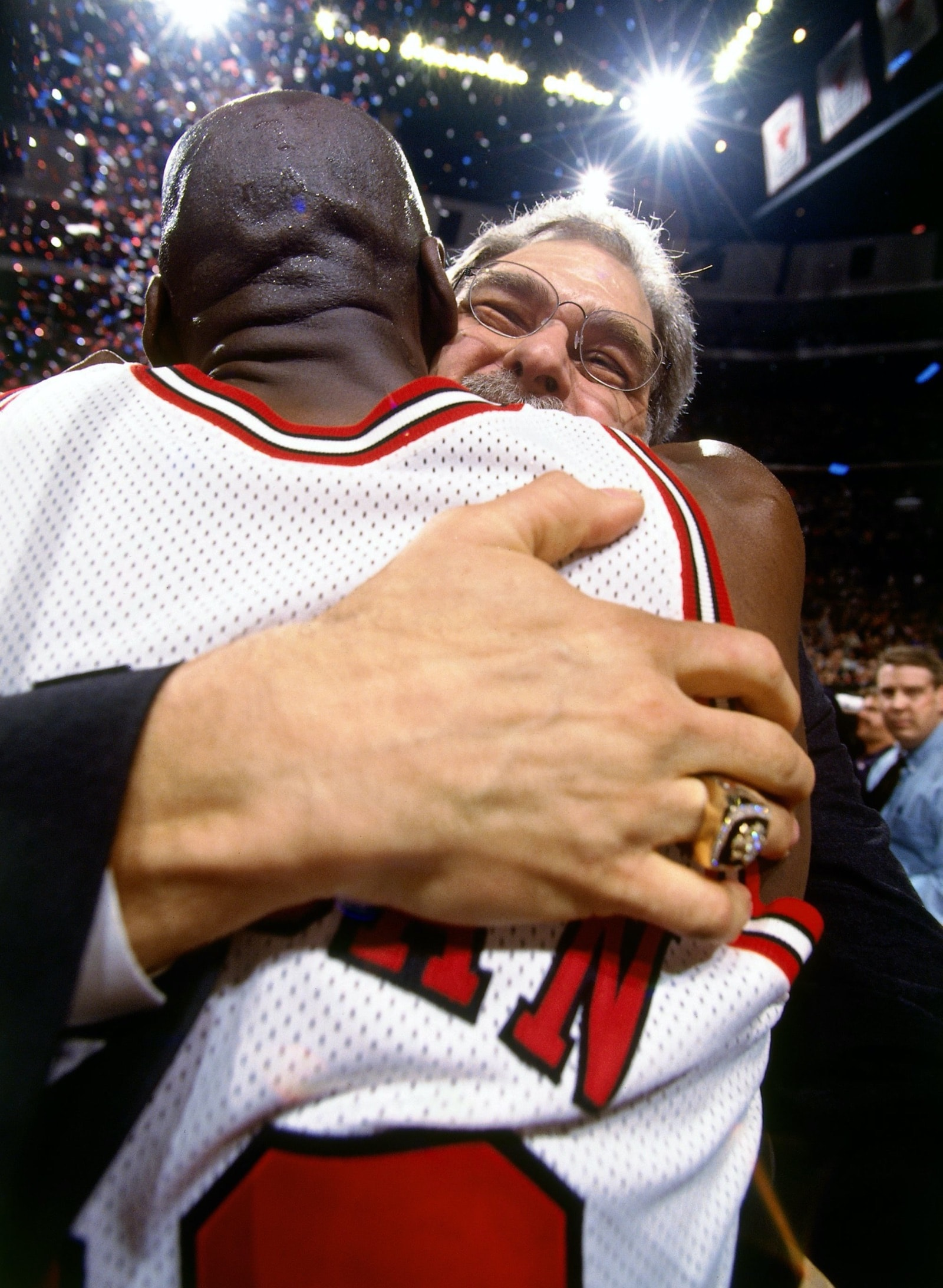 Phil Jackson and Michael Jordan hug it out after winning the championship