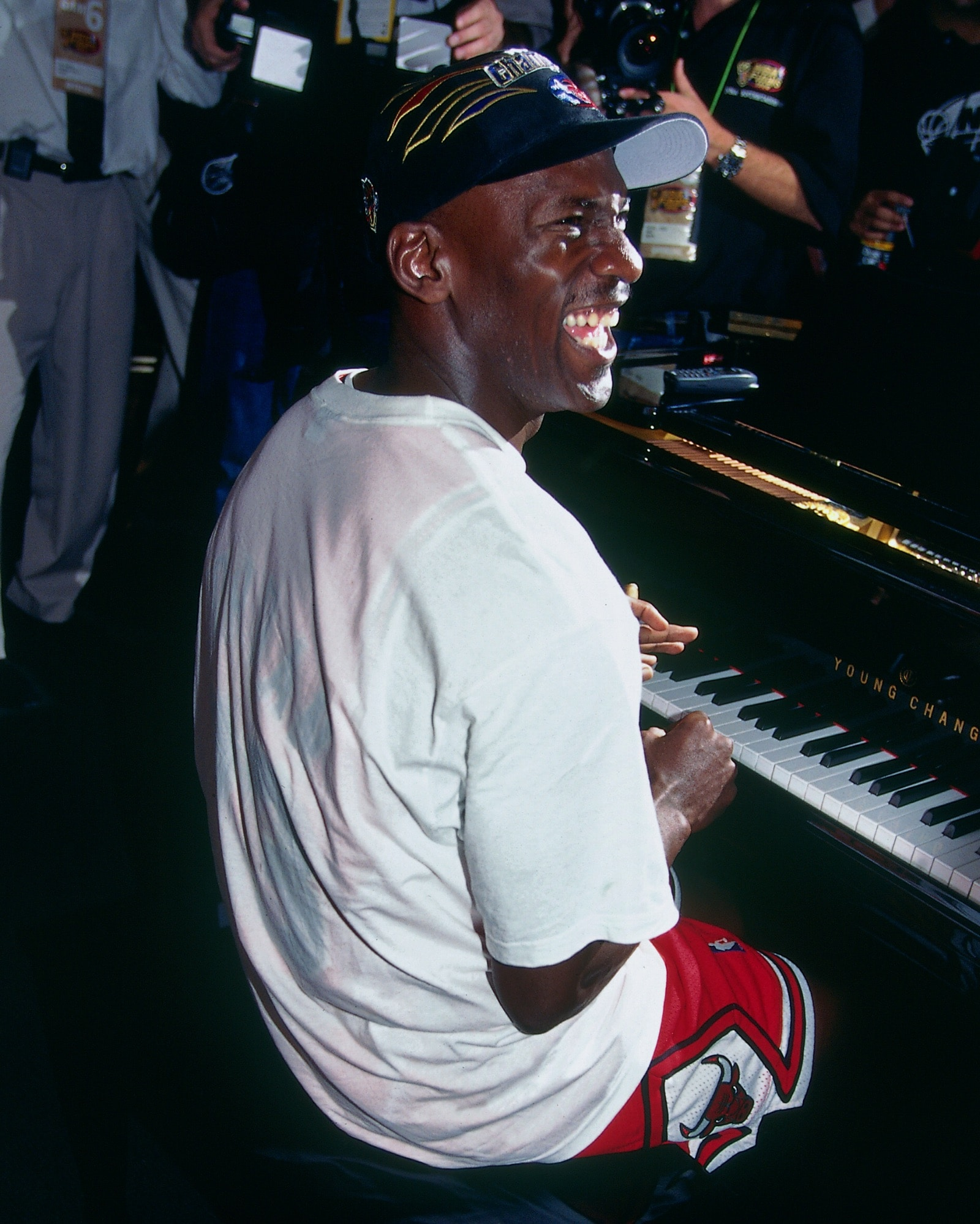 Michael Jordan celebrates on a piano after winning the 1998 NBA Championship