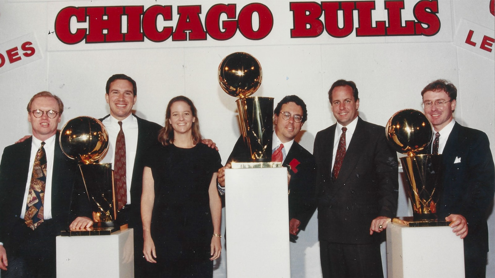 Keith Brown, far right, poses with the NBA championship trophies from the first three-peat.