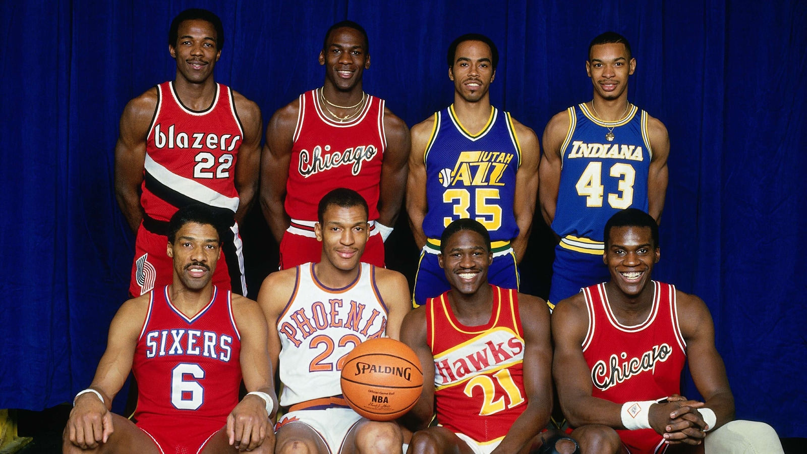 Michael Jordan poses with fellow All-Star slam dunk contest participants, including Julius Erving, in 1985.