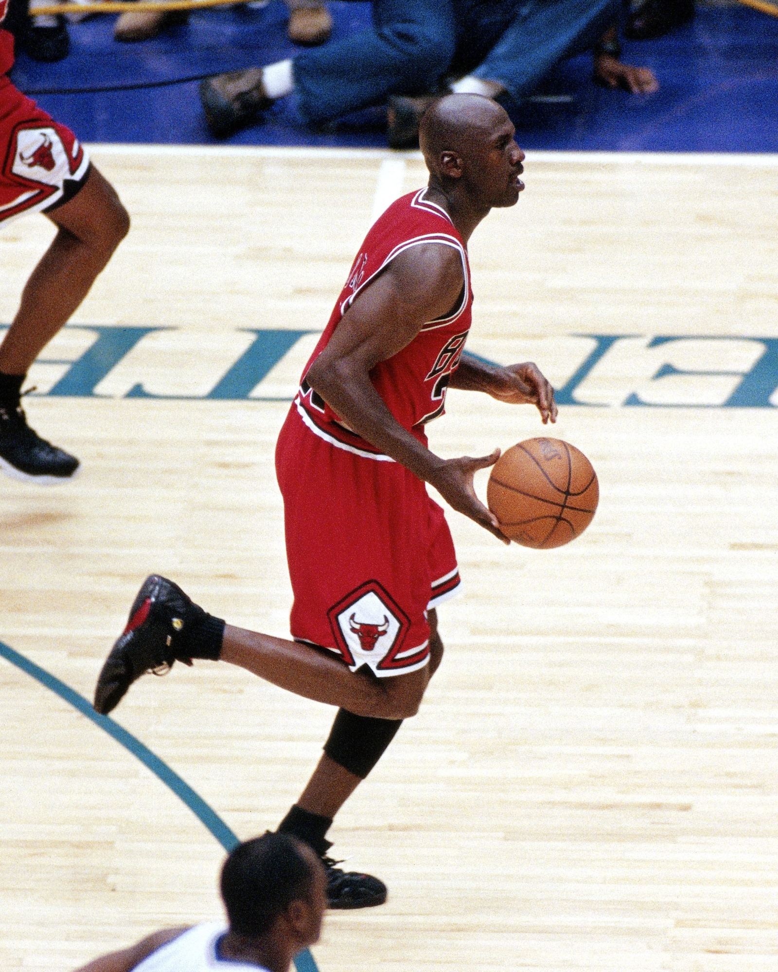 Jordan dribbles up the floor after stealing the ball from Karl Malone in the game's final moments.