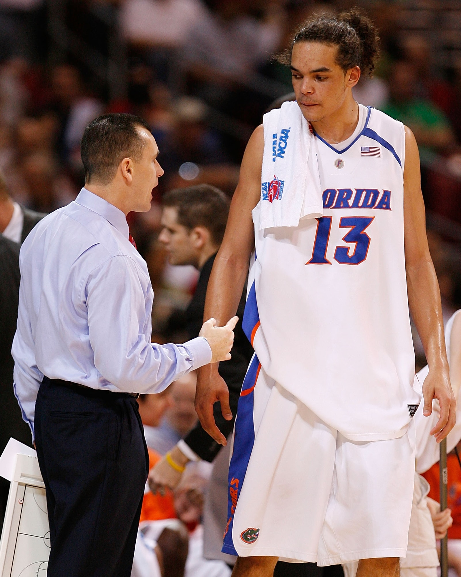 Billy Donovan coaching former Bull Joakim Noah at the University of Florida