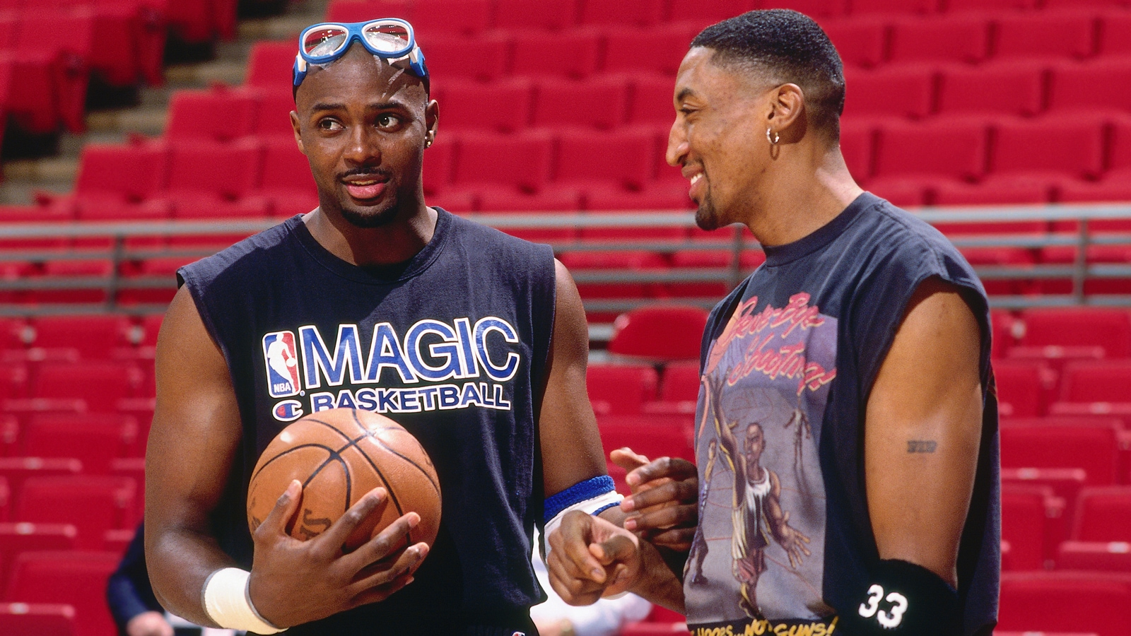Horace Grant, as a member of the Orlando Magic, chats with Scottie Pippen pregame