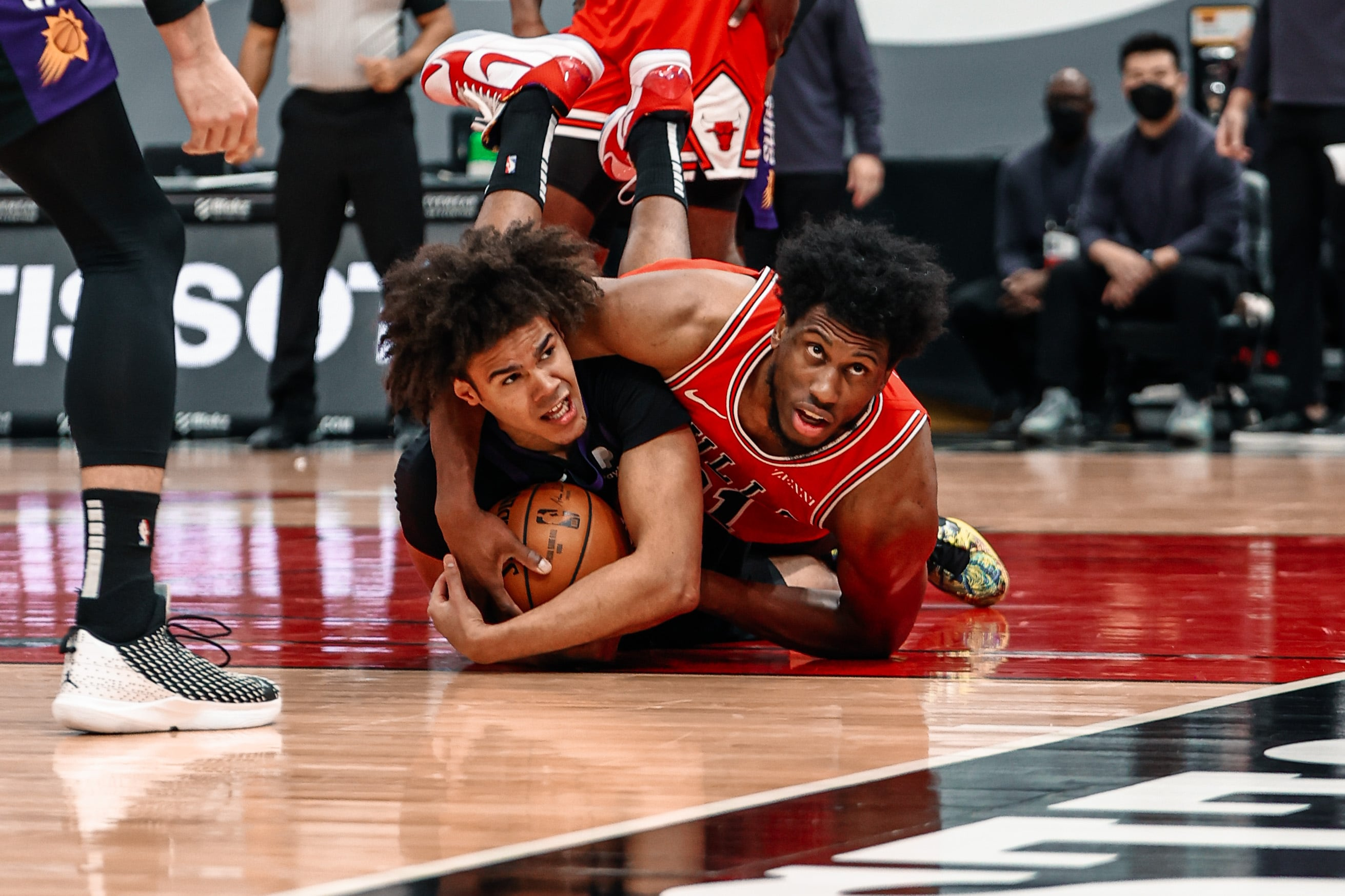Thad Young dives on the floor for a loose ball with Phoenix's Cameron Johnson
