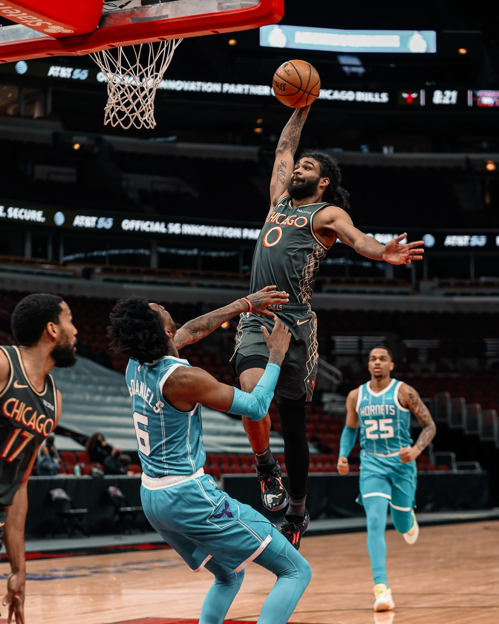 Coby White rises up for a dunk over Charlotte during the 2020-21 season.