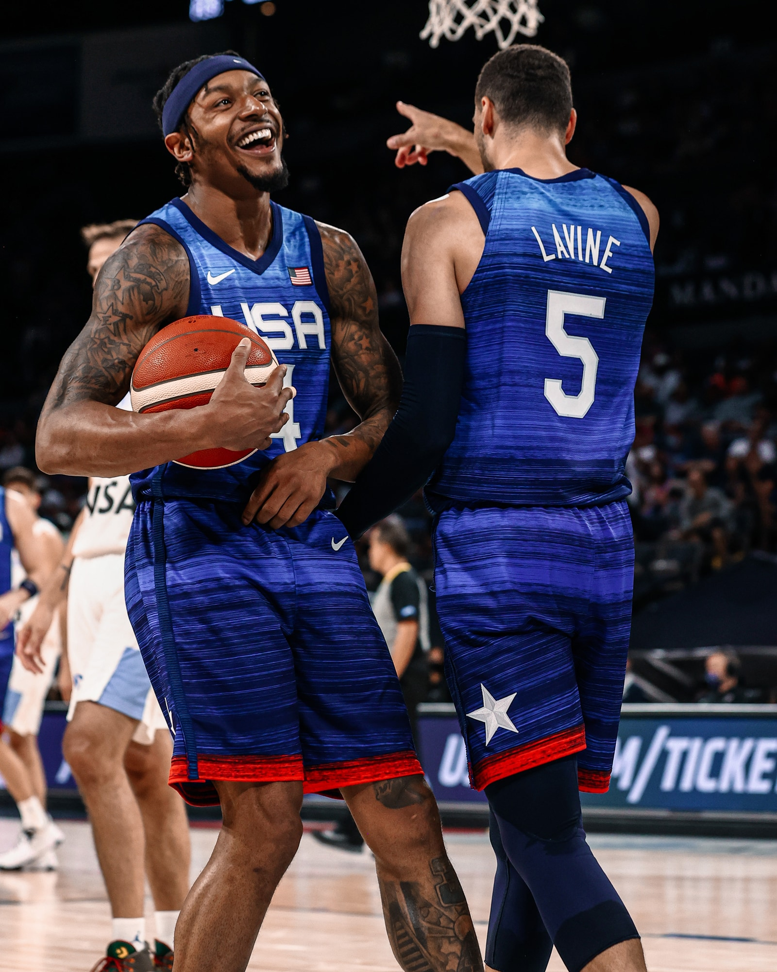 Bradley Beal smiles and reacts to LaVine's ferocious poster dunk against Argentina