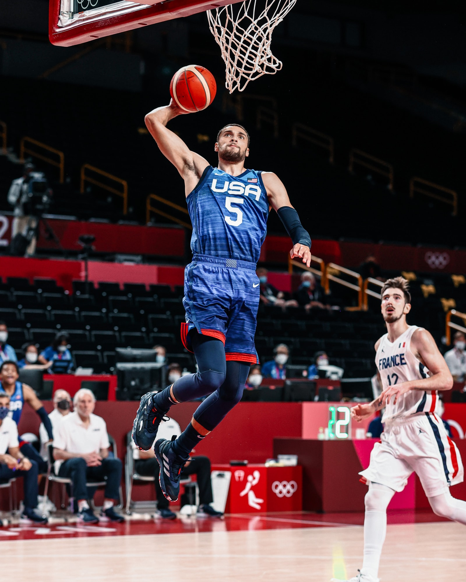 Zach LaVine skies for a breakaway dunk against France in his Olympic debut.
