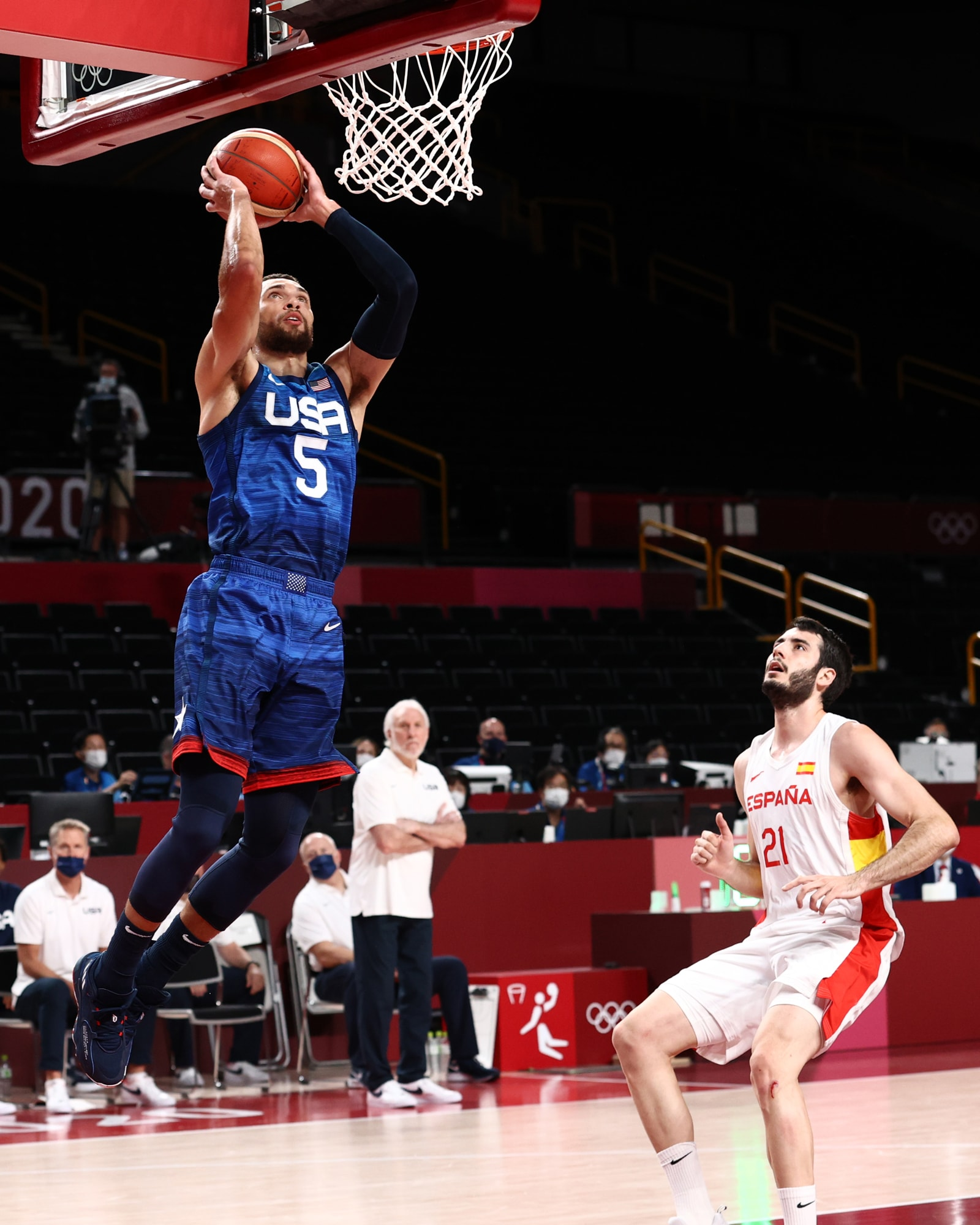Zach LaVine skies for a dunk as Spain's Alex Abrines looks on.