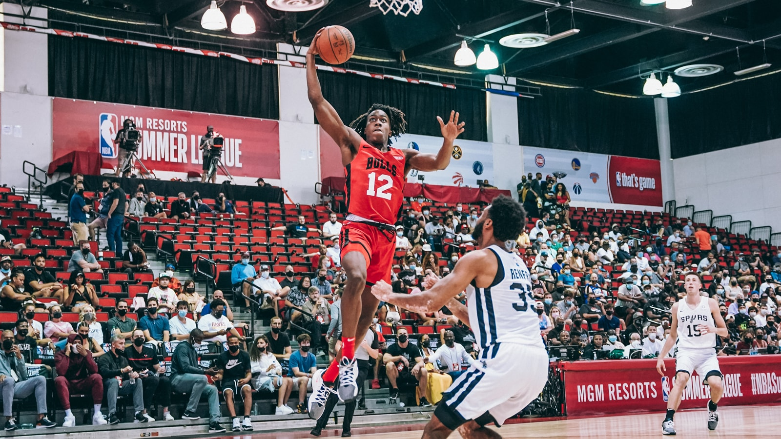 Ayo Dosunmu rises up for a transition dunk against the Spurs in Summer League