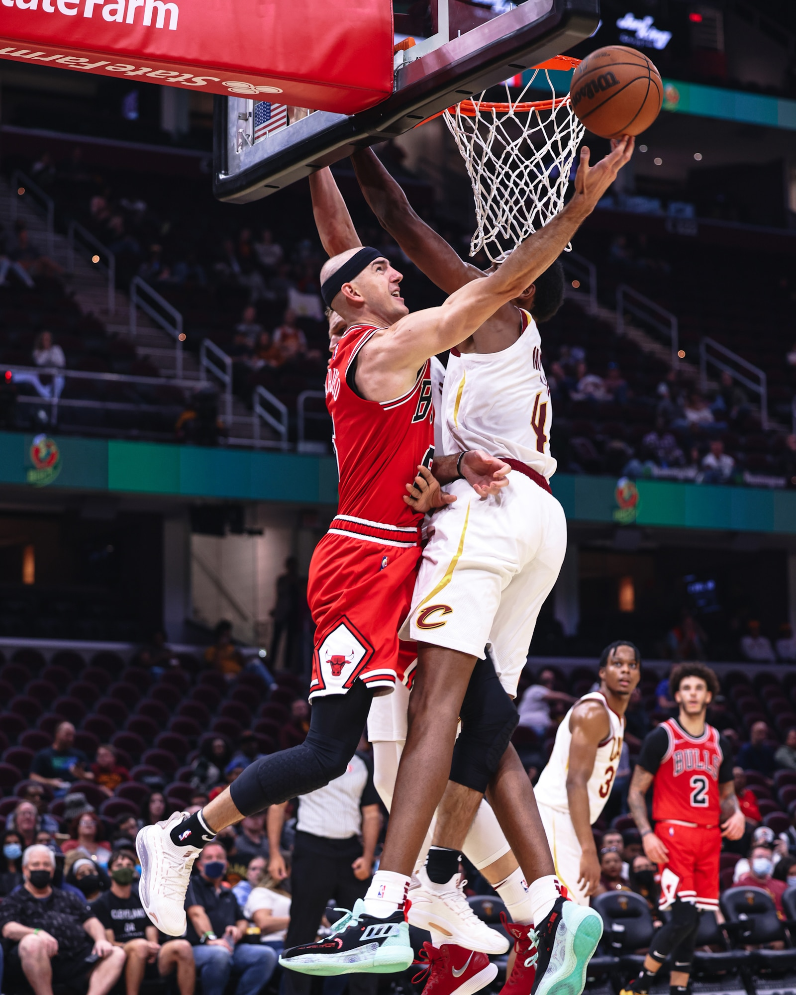 Alex Caruso goes up for a layup in the teeth of Cleveland's defense during preseason.