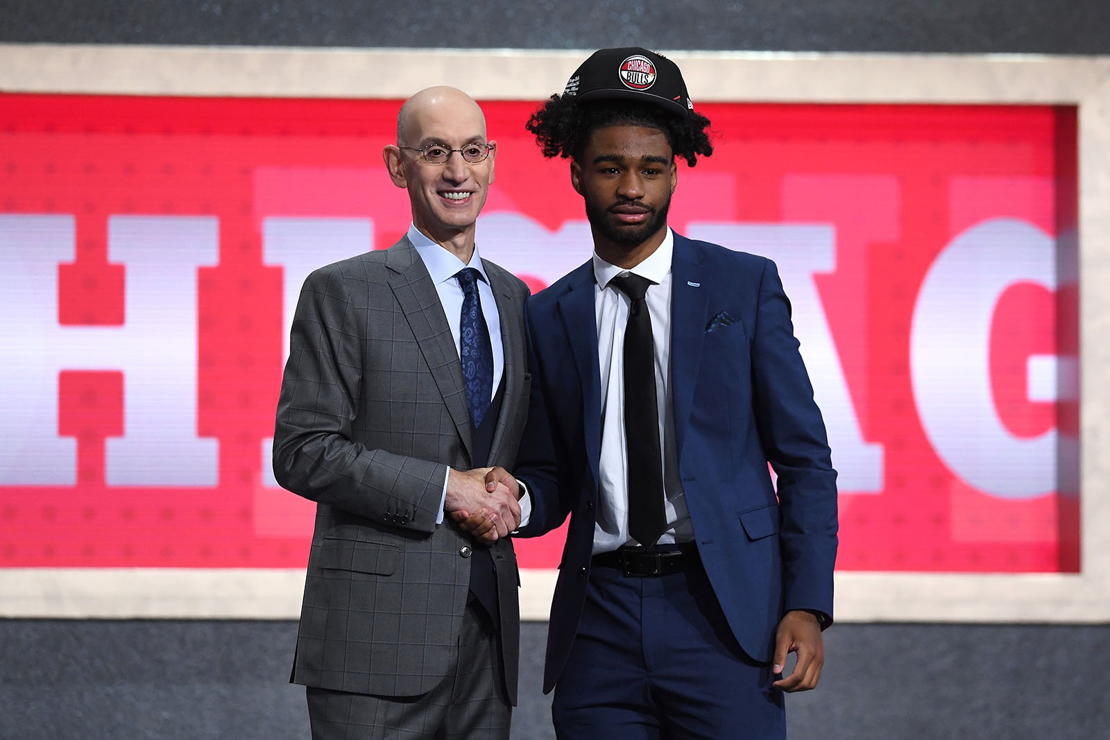 Coby White shakes hands with Adam Silver at the 2019 NBA Draft