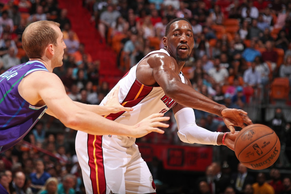 Bam Adebayo #13 of the Miami Heat passes the ball against the Charlotte Hornets on March 11, 2020 at American Airlines Arena in Miami, Florida.