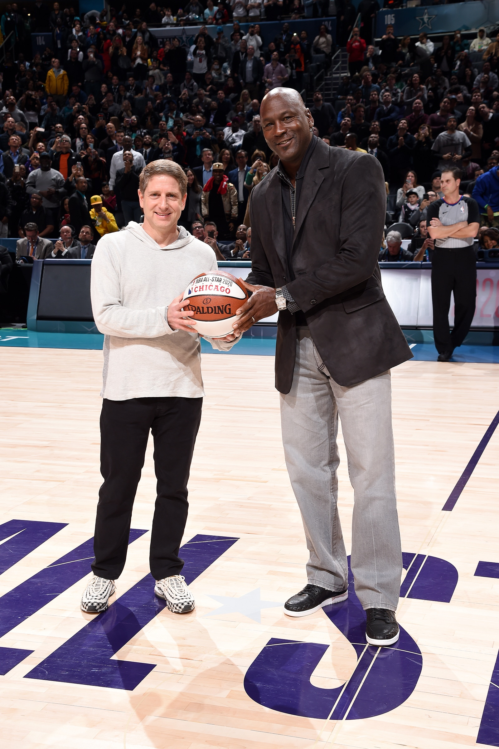 Michael Jordan passes the All-Star game ball over to Michael Reinsdorf