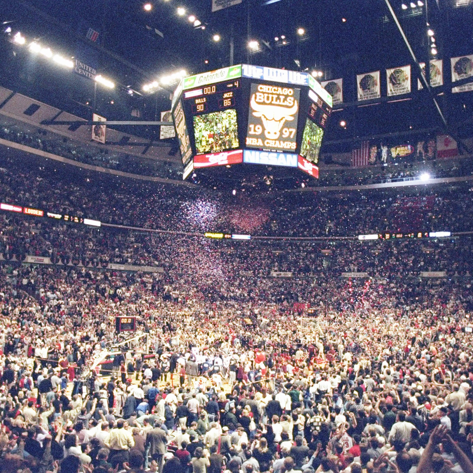 Fans and players floor the UC floor after the Bulls win the 1997 championship