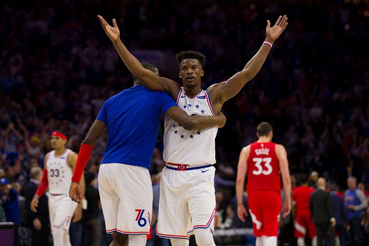 Jimmy Butler #23 of the Philadelphia 76ers reacts along with James Ennis III #11 at the end of the second quarter of Game Six of the Eastern Conference Semifinals against the Toronto Raptors at the Wells Fargo Center on May 9, 2019 in Philadelphia, Pennsylvania.